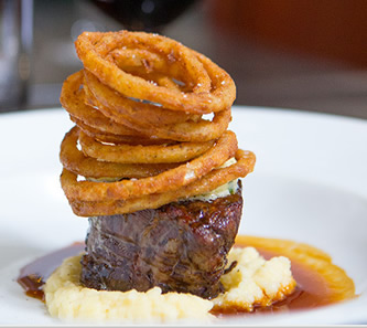 Beef fillet on mash & onion rings