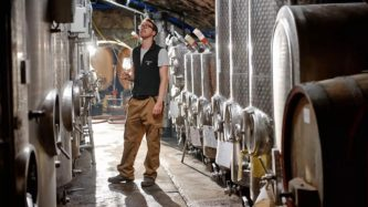 Johannes Hasselbach stands in the Gunderloch cellars. Few people can work in the small space right now with social distancing rules. (Chris Janik)