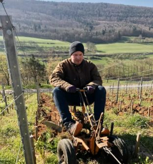 Sebastian Fürst plows one of his steep vineyards in Franken. Vineyard work continues, with workers staying two meters apart. (Photo courtesy of Rudolf Fürst)