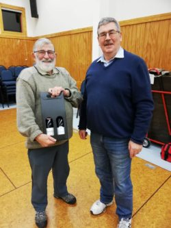 Robin Semmens presented with a wine box set from Wayne Kennedy