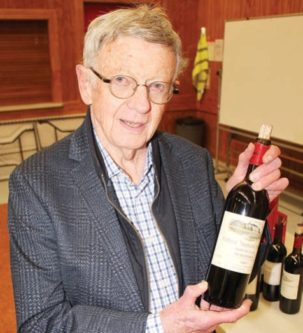 Lover of wine Alan Evans with one of his favourites a bottle of 1997 Chateau Troplong Mondot.