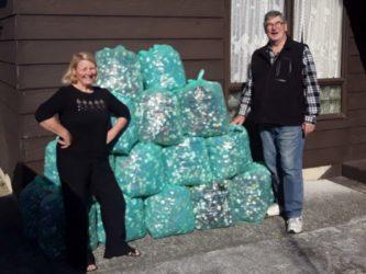 Anne Megget & Wayne Kennedy with 27 bags of wine bottle screwcaps for Kidney Kids