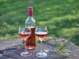 Rosé wine is made by removing skins from red grapes. Dulin/Getty Images